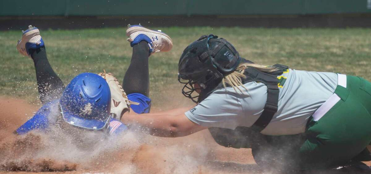 Midland College catcher Gisselle Dominguez makes the tag for an out on Odessa College's Kaylean Ayala 04/23/2021 at Midland College softball field. Tim Fischer/Reporter-Telegram