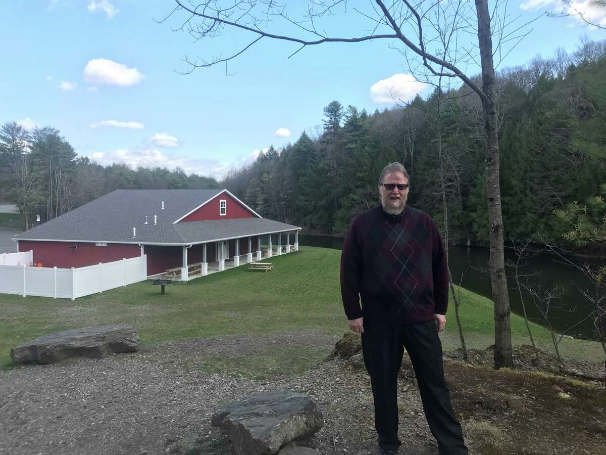 East Greenbush Supervisor Jack Conway stands on a rise above the Red Barn in East Greenbush Town Park on Friday April 23, 2021