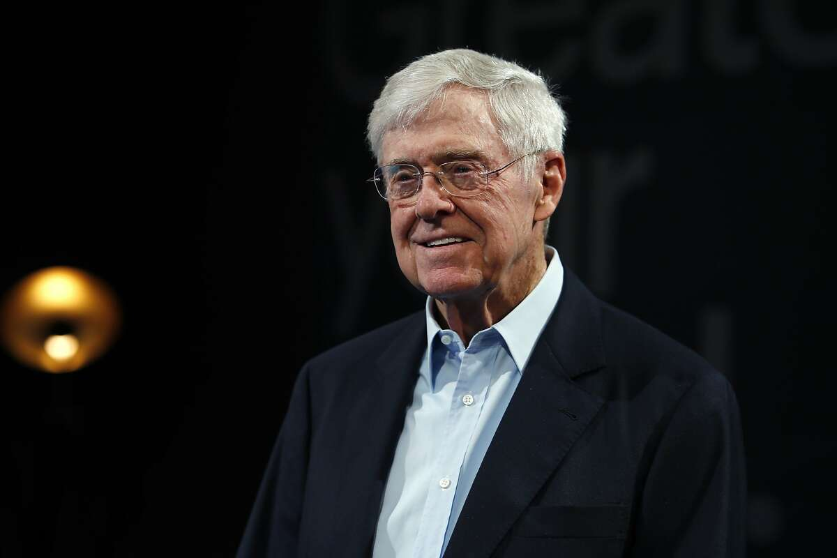 """A political advocacy group run by billionaire Charles Koch """"played a significant and disproportionate role campaigning for your confirmation to the Supreme Court while its corporate sibling's case was pending"""" on a challenge to the California law, Democrats said in a letter to Supreme Court Justice Amy Coney Barrett."""