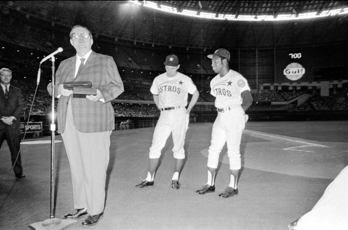 Prior to a baseball game in the Astrodome Aug. 11, 1969, Roy Hofheinz presents honors to Houston Astros Denis Menke and Jimmy Wynn for setting a National League record when both players hit grand slams in the same inning in the July 30 Astros game against the New York Mets in Shea Stadium.