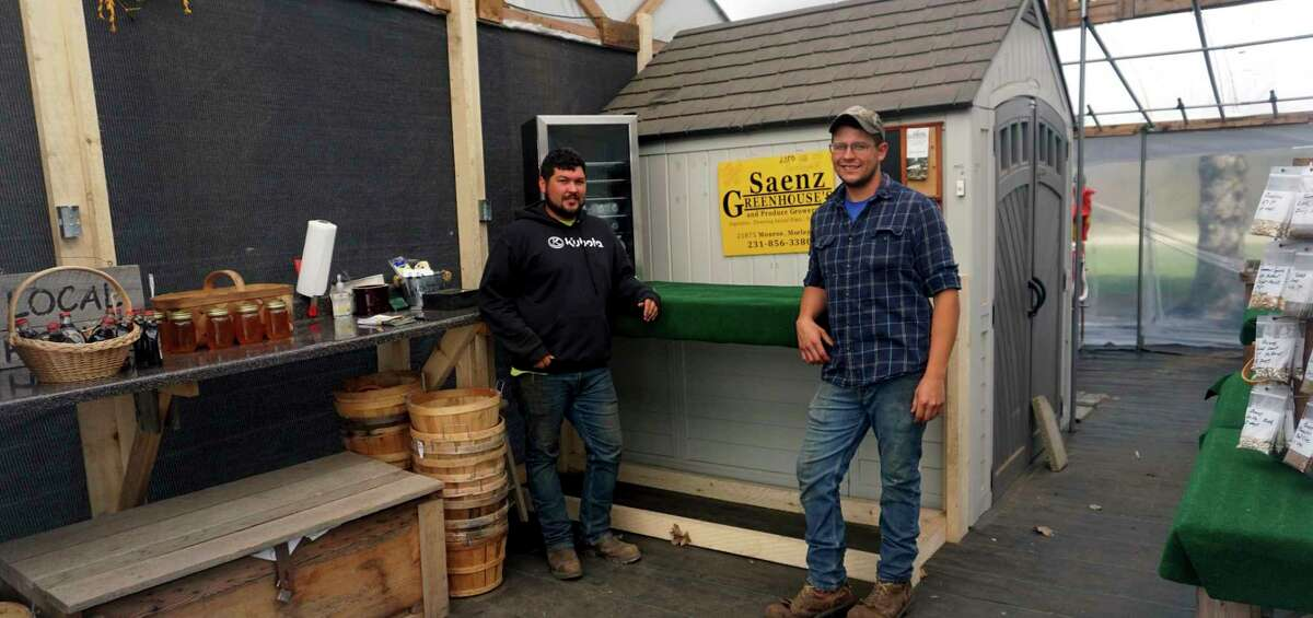 Nate Saenz (left) and his brother, Don, pose among some locally made products inside of their open-air market Friday afternoon. (Pioneer photo/Joe Judd)