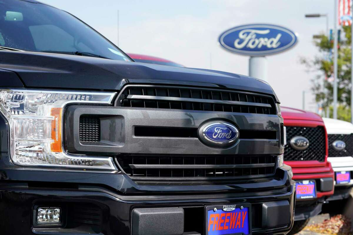 A row of 2020 F-150 pickup trucks. Houston-area dealers sold 25,830 vehicles last month, the highest monthly volume in 15 months.