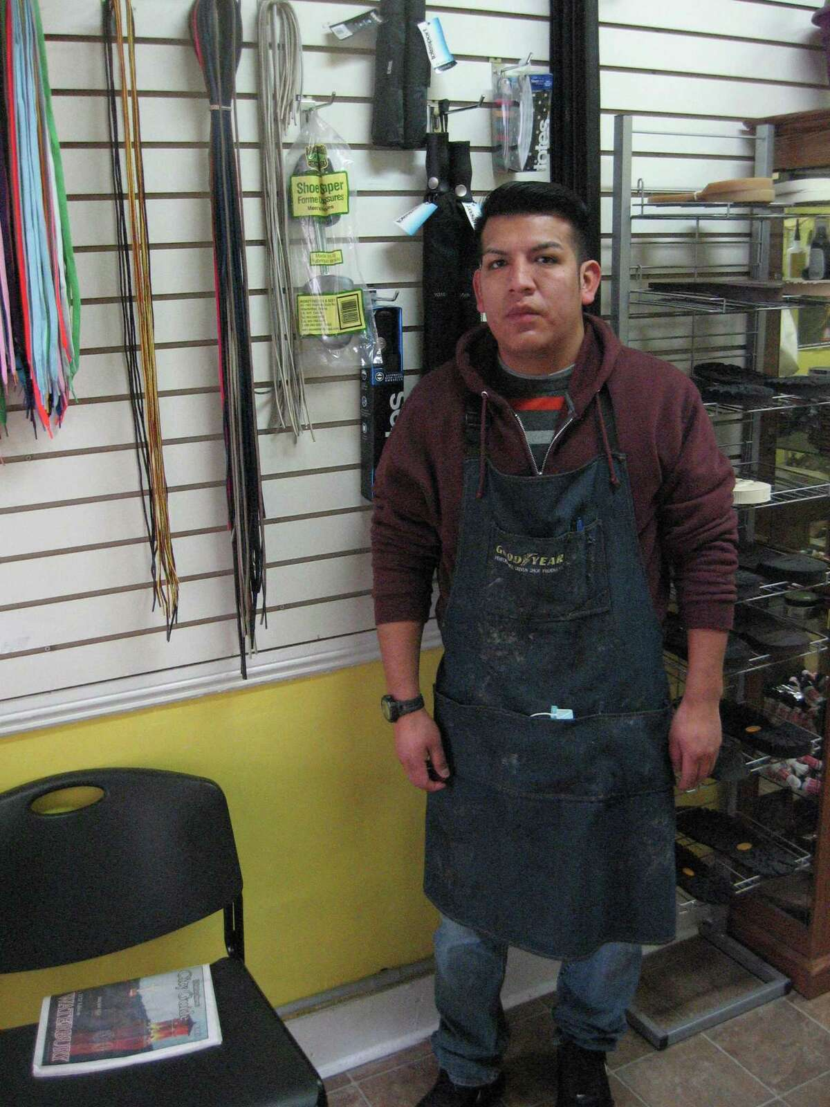 """Manny's Shoe Repair owner Manuel """"Manny"""" Prieto at work. His shoe repair shop is tucked into a space on Main Street in downtown Torrington."""