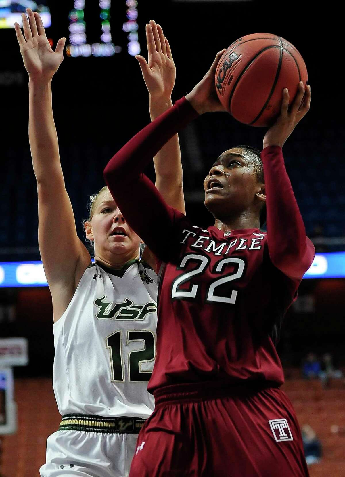 Temple's Tanaya Atkinson shoots as South Florida's Maria Jespersen, left, defends during the second half of an NCAA college basketball game in the American Athletic Conference tournament semifinals at Mohegan Sun Arena, Sunday, March 6, 2016, in Uncasville, Conn. South Florida won 64-46. (AP Photo/Jessica Hill)