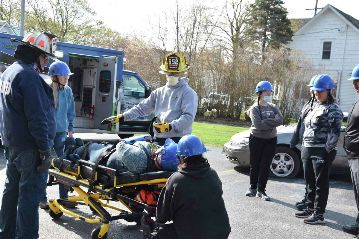 West Shore Community College's EMT class took part in entrapment scenario training attheManistee City Fire Department on Friday.Once a victim was removed from the vehicle, EMT students learned how to properly load them into an ambulance.(Arielle Breen/News Advocate)