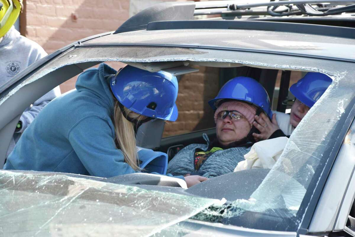 On Friday morning, West Shore Community College EMT students participated in a training scenariowith the Manistee City Fire Department where a victim of a vehicle crash was trapped inside the vehicle and in need of medical attention. (Arielle Breen/News Advocate)