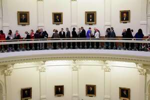 Visitor line up in the Texas Capitol to enter the House Chambers for the beginning of the 2015 legislative session, Tuesday, Jan. 13, 2015, in Austin, Texas. (AP Photo/Eric Gay)
