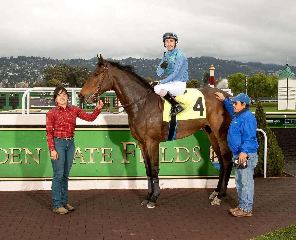 Trainer Victor Trujillo, right, stands with Kiwi's Dream in the winner's circle at Golden Gate Fields following an allowance-race victory March 6, 2020. Kiwi's Dream has finished second in four of five stakes appearances since that win.