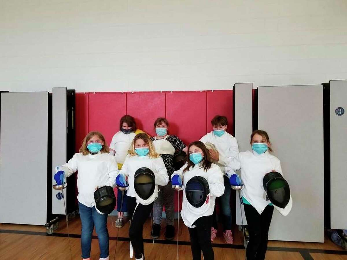 The newly created Betsie Valley Fencing Club is made up of eight fifth-grade girls taught byJuliaKline, SEEDS site coordinator forafterschool program for Betsie Valley. (Courtesy Photo)