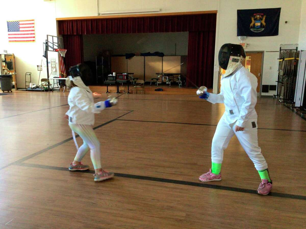 Students in the Betsie Valley Fencing Club face off against each other in a bout to learn more about fencing and practice their techniques. (Couretsy Photo)