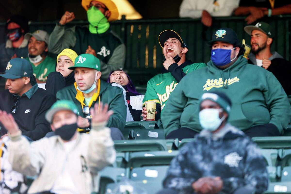 Fans watch the Oakland Athletics against the Minnesota Twins during the first game of an MLB doubleheader at RingCentral Coliseum on Tuesday, April 20, 2021, in Oakland, Calif.