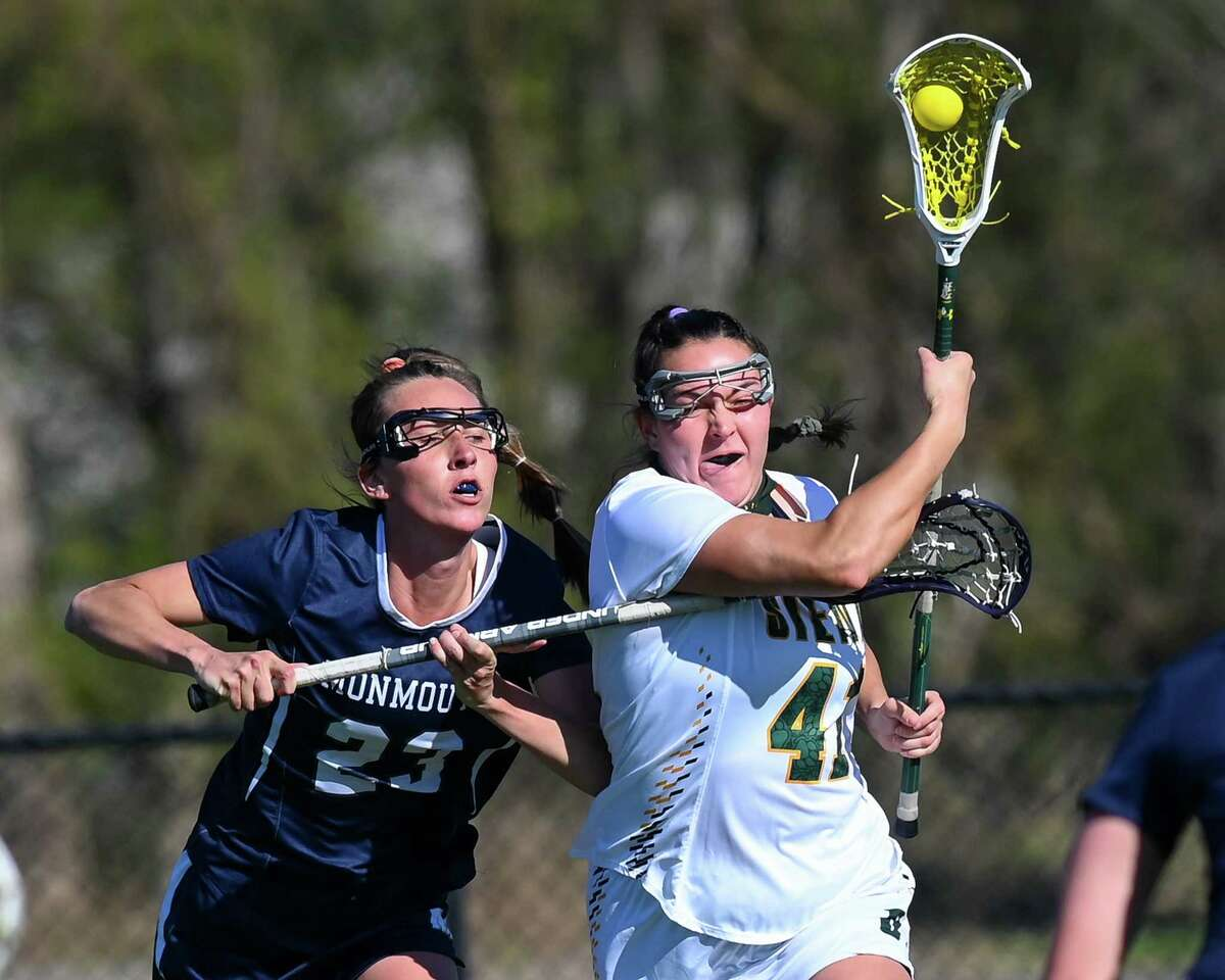 Siena fifth year student Annie Brennan makes a move in front of Monmouth fifth year student Chloe Novak during a game at Siena College in Loudonville, NY, on Friday, April 23, 2021. (Jim Franco/Special to the Times Union)