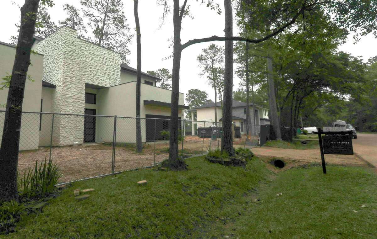 """Both Jordan Marie Schilleci, a long-time licensed REALTOR and owner of Jo & Co. Realty Group and Beth Ferester, owner of Beth Ferester & Co. and also a licensed REALTOR affiliated with Coldwell Banker, said the real estate and housing market in The Woodlands is """"red hot."""" Construction and renovations continue on homes along South Timber Top Drive, Friday, April 23, 2021, The Woodlands."""