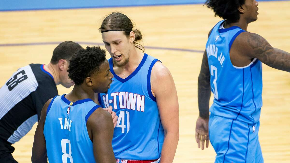 Houston Rockets forward Kelly Olynyk (41) talks to Houston Rockets forward Jae'Sean Tate (8) between plays during the third quarter of an NBA game between the Houston Rockets and Indiana Pacers on Wednesday, April 14, 2021, at Toyota Center in Houston.