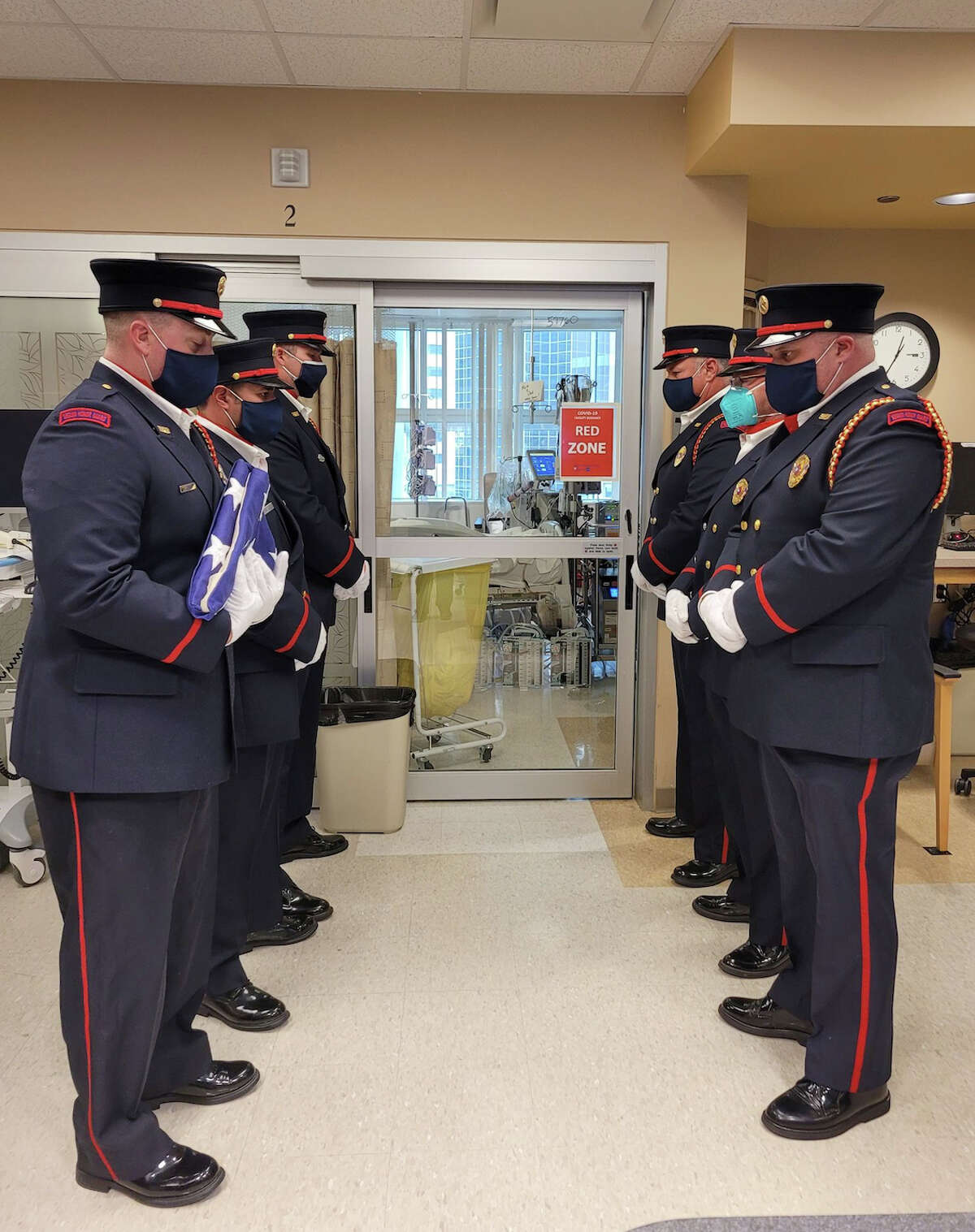 A Seguin Firefighter Honor Guard stand outside the hospital room of Seguin Firefighter/Paramedic Roger Dean Friday, April 23, 2021, in Houston.