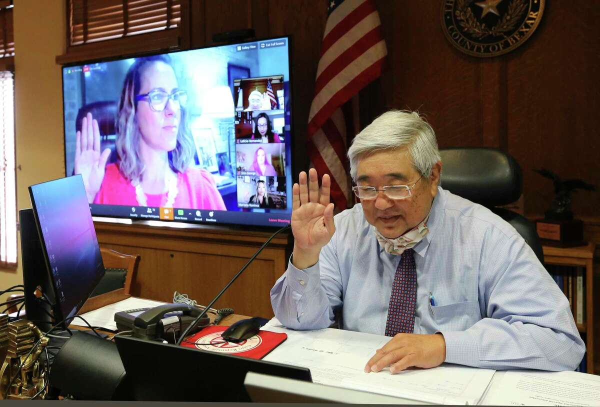 State District Judge Peter Sakai, shown swearing in a new Child Advocates San Antonio (CASA) volunteer on April 17, 2020, announced he will resign his 225th Civil District Court seat, effective Oct. 31, 2021.