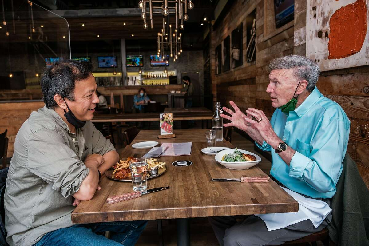 Dr. Michael Lu (left), dean of the UC Berkeley School of Public Health, dines out in Berkeley with former dean Stephen Shortell for the first time in more than a year.