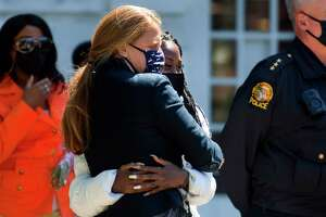 Amira Francois, a student at Greenwich Academy, and a Racial Justice Scholarship winner, gets a hug from school counselor Charlanne Zepf during YWCA Greenwich's Stand Against Racism event outside of Town Hall in Greenwich, Conn., on Friday April 23, 2021. This small in-person gathering included the awarding of the Racial Justice Scholarships by the Superintendent of Greenwich Public Schools to four students and brief remarks from the First Selectman and YWCA Greenwich.