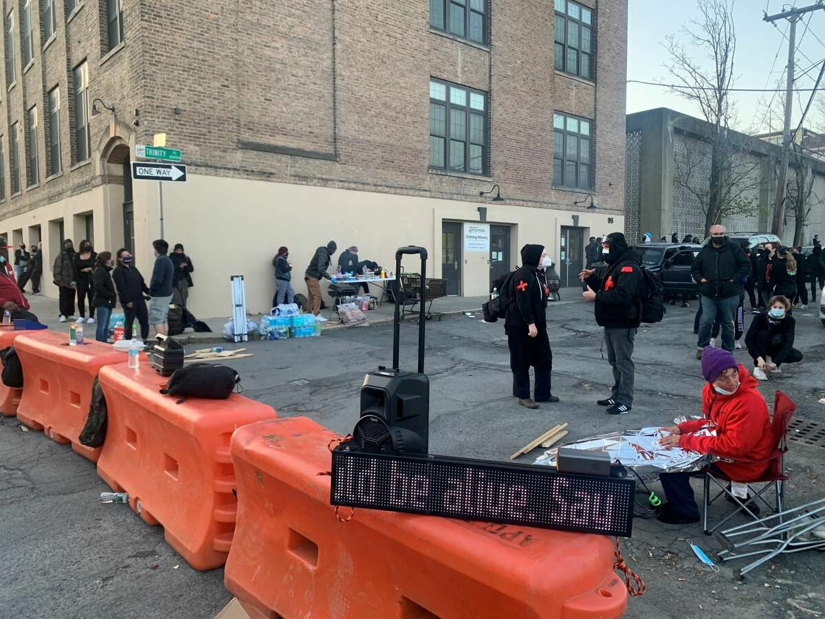 Social justice/anti-police brutality activists gathered outside Albany police's South Station on Friday, April 23, 2021. (Steve Barnes/Times Union)
