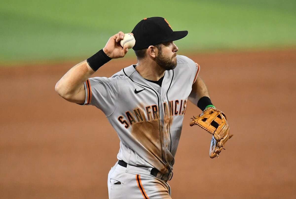 MIAMI, FLORIDA - APRIL 18: Evan Longoria #10 of the San Francisco Giants makes the throw to first in the eighth inning against the Miami Marlins at loanDepot park on April 18, 2021 in Miami, Florida. (Photo by Mark Brown/Getty Images)