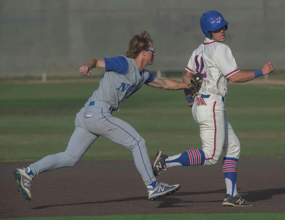 Midland Christian's Rhett Clark is tagged out in a run down between first and second by FW Nolan Catholic's Henry Doskocil but not before Clark extended the play the to allow a run to score 04/23/2021 at Christensen Stadium. Tim Fischer/Reporter-Telegram