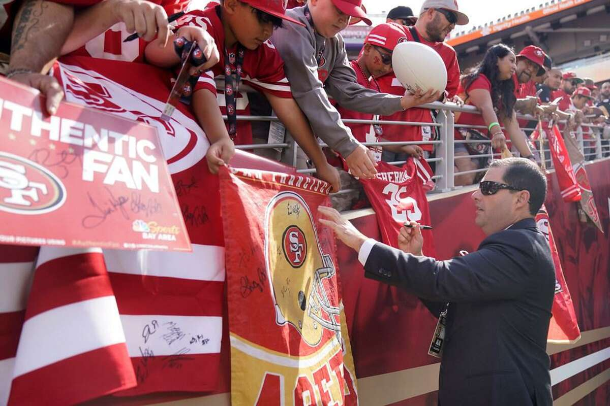 San Francisco 49ers owner Jed York signs autographs before an NFL football game between the 49ers and the Pittsburgh Steelers in Santa Clara, Calif., Sunday, Sept. 22, 2019.