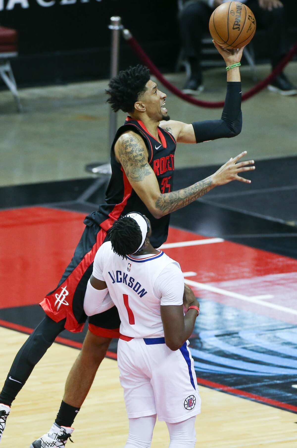 Houston Rockets center Christian Wood (35) goes up for a layup over LA Clippers guard Reggie Jackson (1) in the first half at the Toyota Center in Houston on Friday, April 23, 2021.