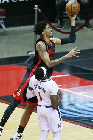 Houston Rockets center Christian Wood (35) goes up for a layup over LA Clippers guard Reggie Jackson (1) in the first half at the Toyota Center in Houston on Friday, April 23, 2021. Photo: Elizabeth Conley/Staff Photographer / © 2021 Houston Chronicle