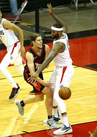 Houston Rockets forward Kelly Olynyk (41) passes the ball around dLA Clippers center DeMarcus Cousins (15) in the first half of game action at the Toyota Center in Houston on Friday, April 23, 2021. Photo: Elizabeth Conley/Staff Photographer / © 2021 Houston Chronicle