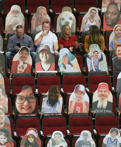 Live basketball fans sit next to cutouts as the Houston Rockets host the LA Clippers at the Toyota Center in Houston on Friday, April 23, 2021. Photo: Elizabeth Conley/Staff Photographer / © 2021 Houston Chronicle