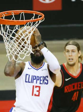 LA Clippers guard Paul George (13) puts up a shot around Houston Rockets forward Kelly Olynyk (41) in the first half at the Toyota Center in Houston on Friday, April 23, 2021. Photo: Elizabeth Conley/Staff Photographer / © 2021 Houston Chronicle