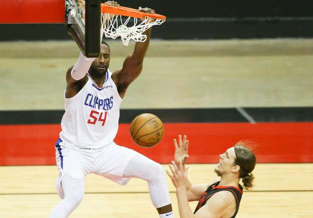 LA Clippers forward Patrick Patterson (54) dunks the ball over Houston Rockets forward Kelly Olynyk (41) in the first half at the Toyota Center in Houston on Friday, April 23, 2021. Photo: Elizabeth Conley/Staff Photographer / © 2021 Houston Chronicle