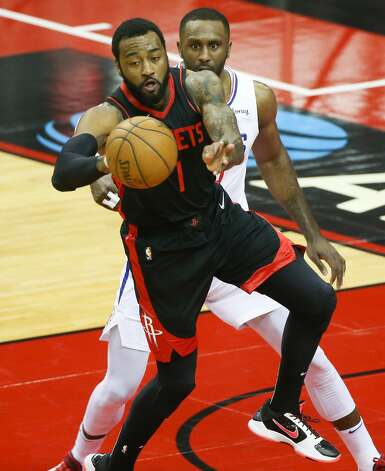 Houston Rockets guard John Wall (1) dishes off the ball in the key against LA Clippers at the Toyota Center in Houston on Friday, April 23, 2021. Photo: Elizabeth Conley/Staff Photographer / © 2021 Houston Chronicle