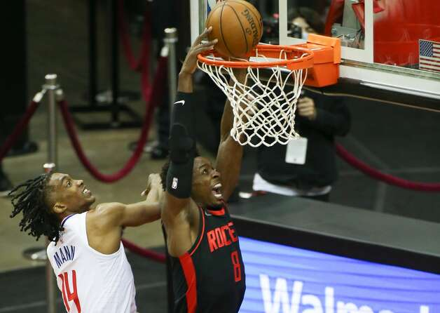 Houston Rockets forward Jae'Sean Tate (8) dunks the ball around LA Clippers guard Terance Mann (14) in the first half at the Toyota Center in Houston on Friday, April 23, 2021. Photo: Elizabeth Conley/Staff Photographer / © 2021 Houston Chronicle