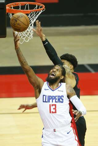LA Clippers guard Paul George (13) puts up a shot in the first half against Houston Rockets at the Toyota Center in Houston on Friday, April 23, 2021. Photo: Elizabeth Conley/Staff Photographer / © 2021 Houston Chronicle