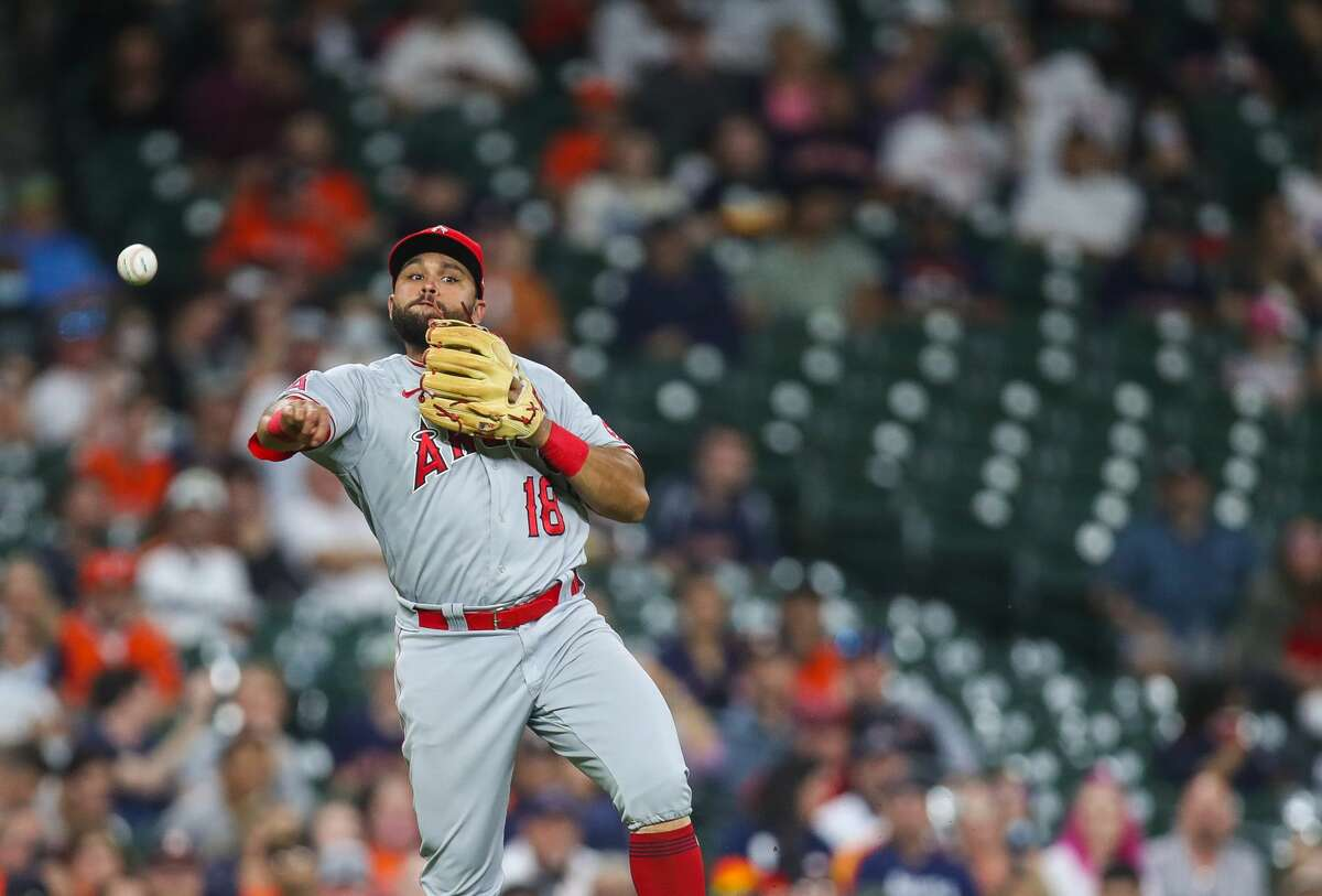 Los Angeles Angels third baseman Jose Rojas (18) throws to first base for an out against the Houston Astros during the fourth inning of an MLB game at Minute Maid Park on Friday, April 23, 2021, in Houston.