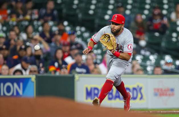 Los Angeles Angels third baseman Jose Rojas (18) throws to first base for an out against the Houston Astros during the fourth inning of an MLB game at Minute Maid Park on Friday, April 23, 2021, in Houston. Photo: Godofredo A Vásquez/Staff Photographer / © 2021 Houston Chronicle