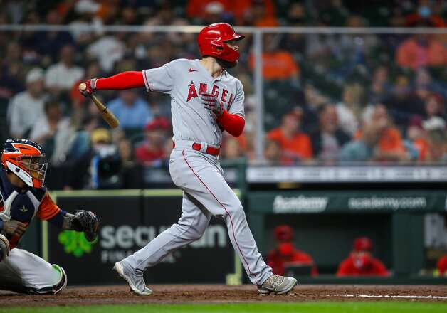 Los Angeles Angels right fielder Jared Walsh (20) hits an RBI single against the Houston Astros during the fifth inning of an MLB game at Minute Maid Park on Friday, April 23, 2021, in Houston. Photo: Godofredo A Vásquez/Staff Photographer / © 2021 Houston Chronicle