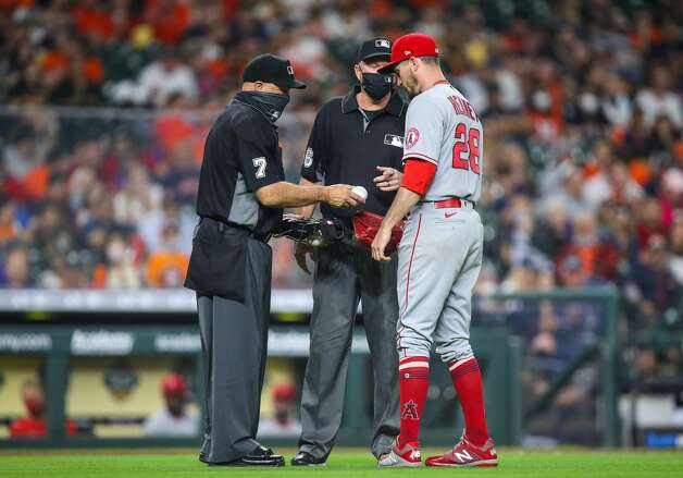 Los Angeles Angels starting pitcher Andrew Heaney (28) asks for a different baseball from umpire Brian O'Nora (7) during the third inning of an MLB game at Minute Maid Park on Friday, April 23, 2021, in Houston. Photo: Godofredo A Vásquez/Staff Photographer / © 2021 Houston Chronicle