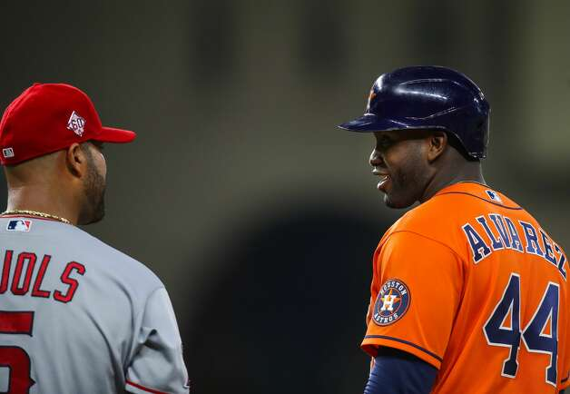 Houston Astros designated hitter Yordan Alvarez (44) talks with Los Angeles Angels first baseman Albert Pujols (5) after being hit by a pitch during the fourth inning of an MLB game at Minute Maid Park on Friday, April 23, 2021, in Houston. Photo: Godofredo A Vásquez/Staff Photographer / © 2021 Houston Chronicle