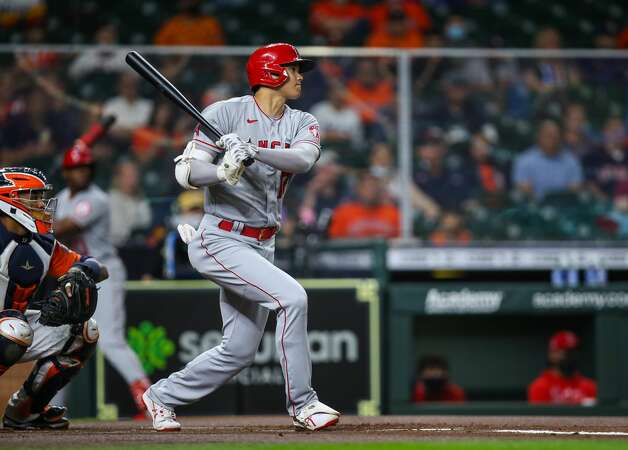 Los Angeles Angels designated hitter Shohei Ohtani (17) hits a single against the Houston Astros during the first inning of an MLB game at Minute Maid Park on Friday, April 23, 2021, in Houston. Photo: Godofredo A Vásquez/Staff Photographer / © 2021 Houston Chronicle