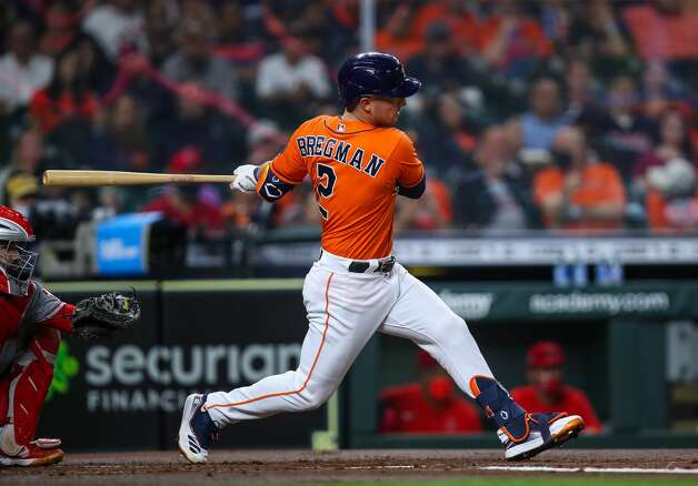 Houston Astros third baseman Alex Bregman (2) hits a single against the Los Angeles Angels during the first inning of an MLB game at Minute Maid Park on Friday, April 23, 2021, in Houston. Photo: Godofredo A Vásquez/Staff Photographer / © 2021 Houston Chronicle