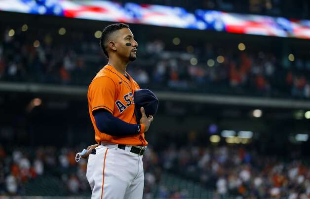Houston Astros second baseman Robel Garcia (9) during the national anthem before the start of an MLB game against the Los Angeles Angels at Minute Maid Park on Friday, April 23, 2021, in Houston. Photo: Godofredo A Vásquez/Staff Photographer / © 2021 Houston Chronicle
