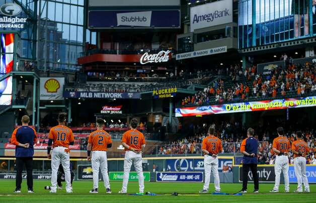 Houston Astros during the national anthem before the start of an MLB game against the Los Angeles Angels at Minute Maid Park on Friday, April 23, 2021, in Houston. Photo: Godofredo A Vásquez/Staff Photographer / © 2021 Houston Chronicle