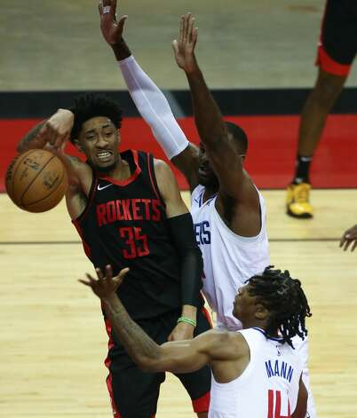 Houston Rockets center Christian Wood (35) looks for a foul as he goes up against LA Clippers defense at the Toyota Center in Houston on Friday, April 23, 2021. Photo: Elizabeth Conley/Staff Photographer / © 2021 Houston Chronicle