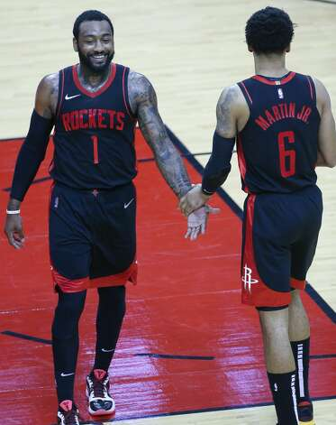 Houston Rockets guard John Wall (1) and teammate Kenyon Martin Jr. (6) congratulate each other inn the second half at the Toyota Center in Houston on Friday, April 23, 2021. Photo: Elizabeth Conley/Staff Photographer / © 2021 Houston Chronicle