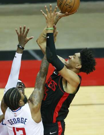 Houston Rockets center Christian Wood (35) attempts a jump shot over LA Clippers guard Paul George (13) in the second half at the Toyota Center in Houston on Friday, April 23, 2021. Photo: Elizabeth Conley/Staff Photographer / © 2021 Houston Chronicle