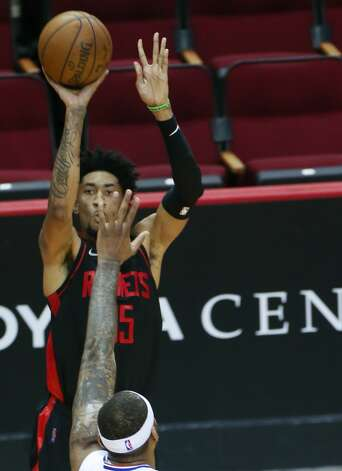 Houston Rockets center Christian Wood (35) puts a sot up over LA Clippers center DeMarcus Cousins (15) inn the second half of game action at the Toyota Center in Houston on Friday, April 23, 2021. Photo: Elizabeth Conley/Staff Photographer / © 2021 Houston Chronicle