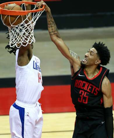 Houston Rockets center Christian Wood (35) dunks the ball past LA Clippers guard Terance Mann (14) at the Toyota Center in Houston on Friday, April 23, 2021. Photo: Elizabeth Conley/Staff Photographer / © 2021 Houston Chronicle