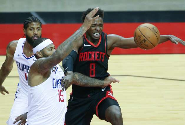 Houston Rockets forward Jae'Sean Tate (8) chases after a loose ball against LA Clippers center DeMarcus Cousins (15) in the second half of game action at the Toyota Center in Houston on Friday, April 23, 2021. LA Clippers won the game 109-104. Photo: Elizabeth Conley/Staff Photographer / © 2021 Houston Chronicle